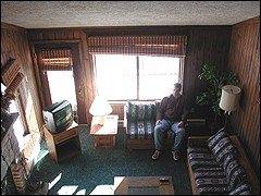 Author Matt Lees enjoys sun streaming in the windows of a Wabasso condo at Snowshoe.