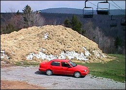 Snowshoe's stash of snow, covered by hay for protection, will be put to good use on May 27.
